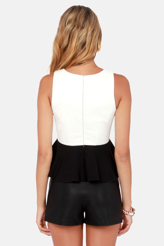 Pros and Contrast Ivory and Black Peplum Top at Lulus.com!