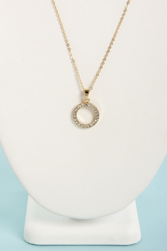This Round's On Me Gold Rhinestone Necklace at Lulus.com!