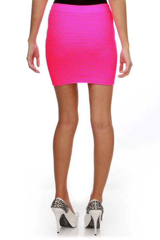 Available In Neon Pink And Neon Green Crop Long Sleeve Top Lined Mini Skirt Mesh Fabric 91% Nylon 9% Spandex Model Is Wearing A Small Available In Neon Pink And Neon Green Crop Long Sleeve Top Lined Mini Skirt Mesh Fabric 91% Nylon 9% Spandex Model Is Wearing A Small.