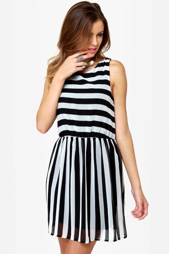 For a basic yet eye-catching daywear look, you really need the Annmarie, white and black, striped ribbed bodycon dress! This extraordinary rayon spandex frock is .