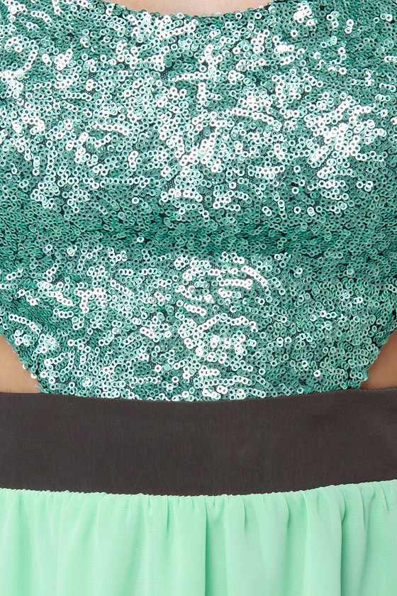Crank up the sequin-frequency with the High Sequin-cy Mint Green High-Low Sequin Dress! Sequin bodice with a tie back, side cutouts, and a high-low chiffon skirt.