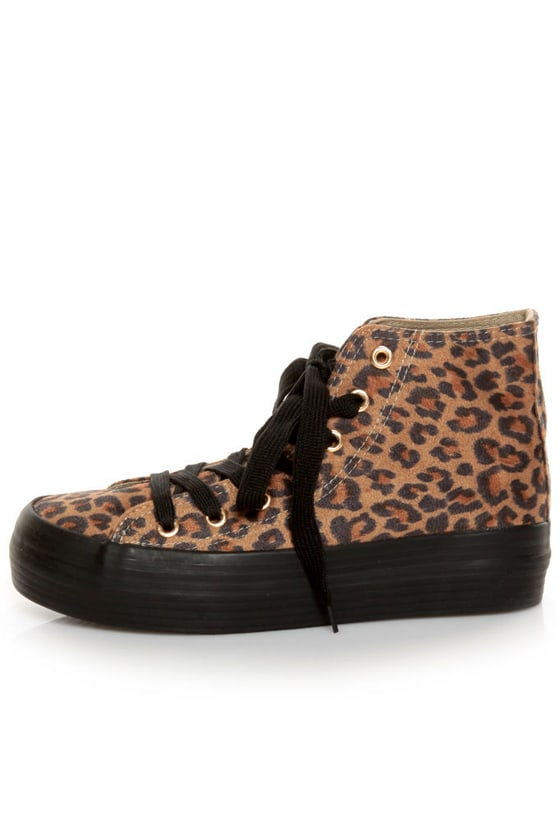 Prowl the streets in these uniquely cool sneakers covered in cheetah print hair-on-hide and accented with tassels. Elastic gores offer easy fit, with a padded footbed, manmade lining and traction rubber platform outsole.