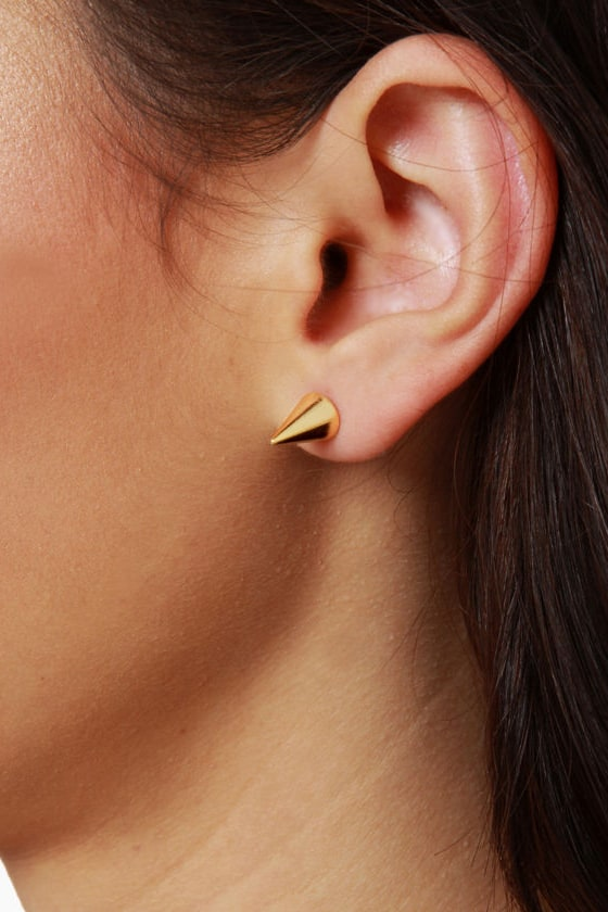 On a Spike Gold Stud Earrings at Lulus.com!